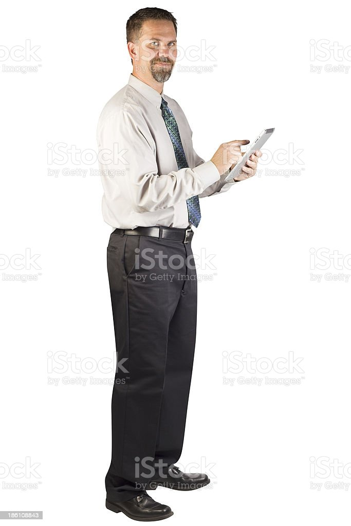 Corporate Man Standing and Using a Tablet Device royalty-free stock photo