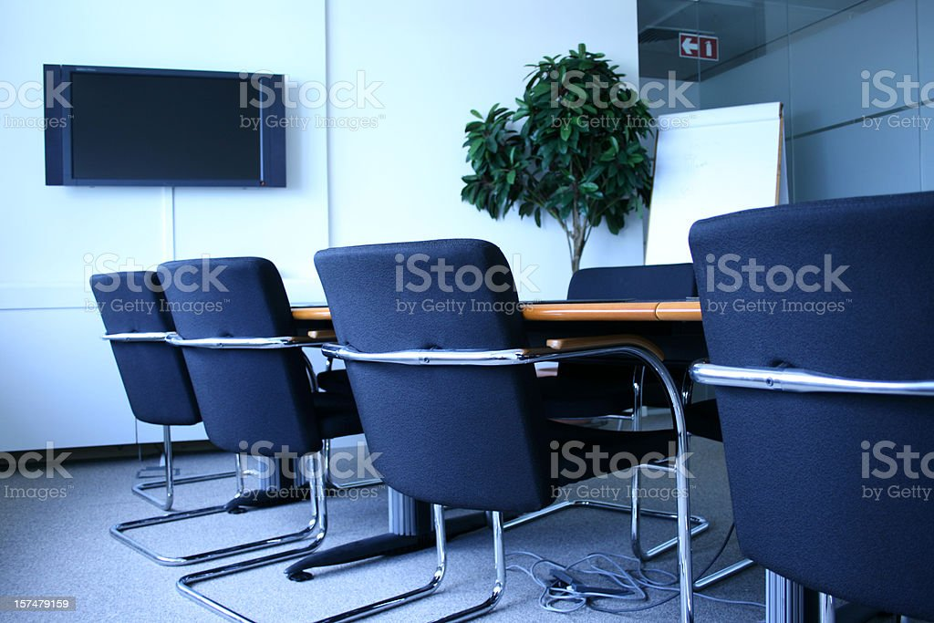 Corporate Office Meeting Room Chairs and TV screen royalty-free stock photo