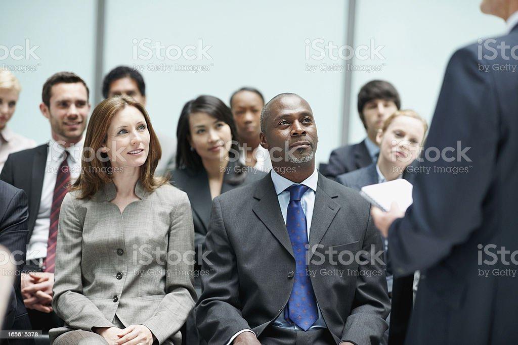 Corporate people attending seminar royalty-free stock photo