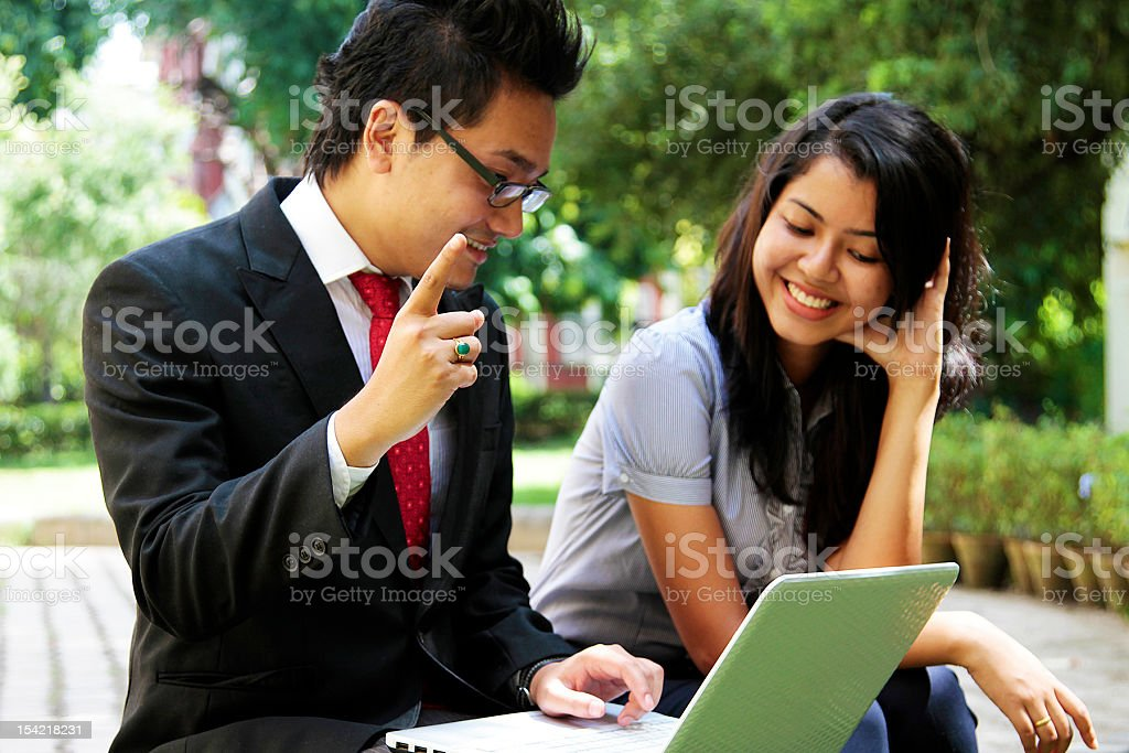 Corporate people discussing while working on a laptop royalty-free stock photo