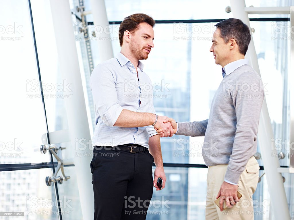 corporate people shaking hands stock photo