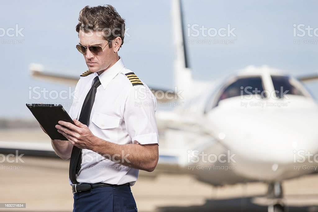 Corporate Pilot Using Electronic Tablet royalty-free stock photo