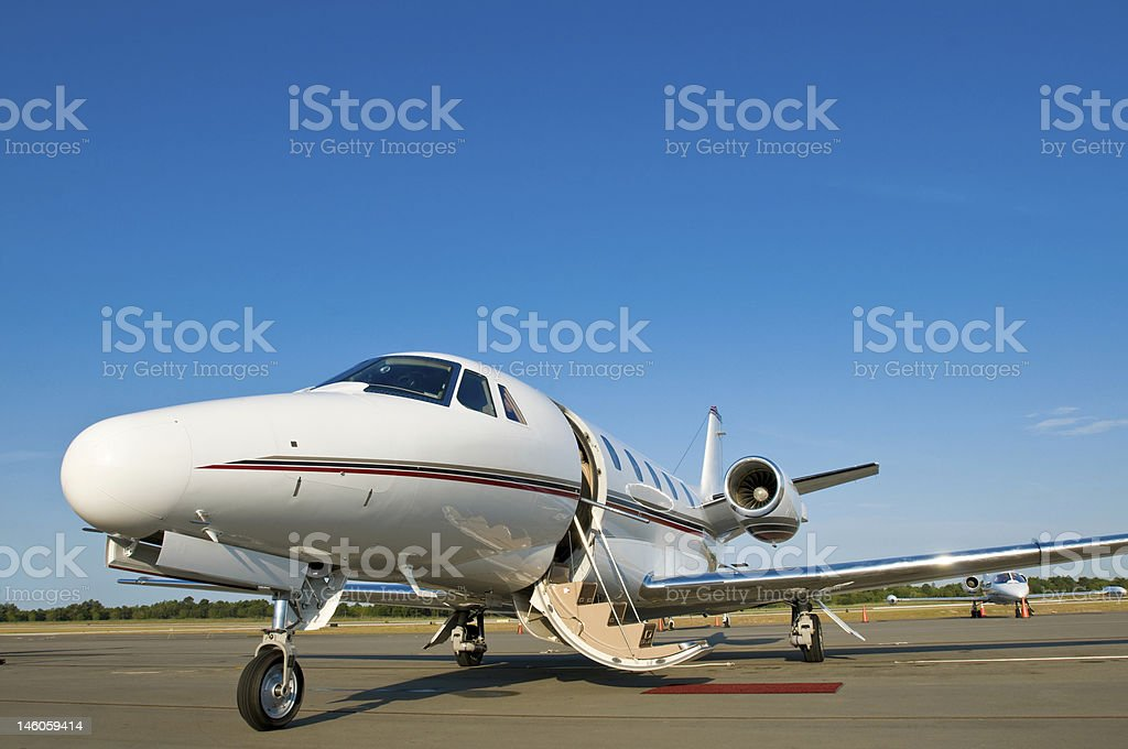 Corporate private jet at airport door open blue sky royalty-free stock photo