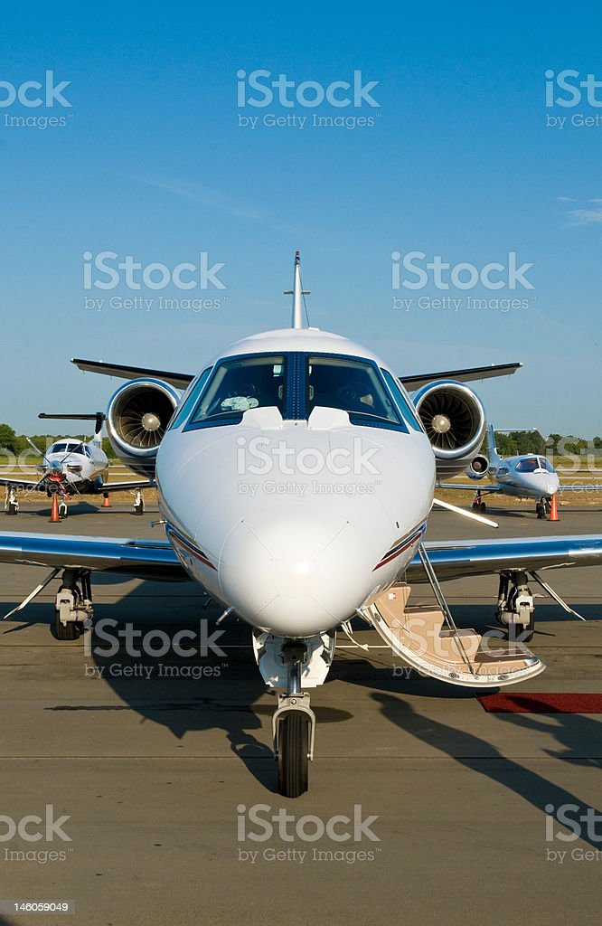 Corporate private jet at airport door open stock photo