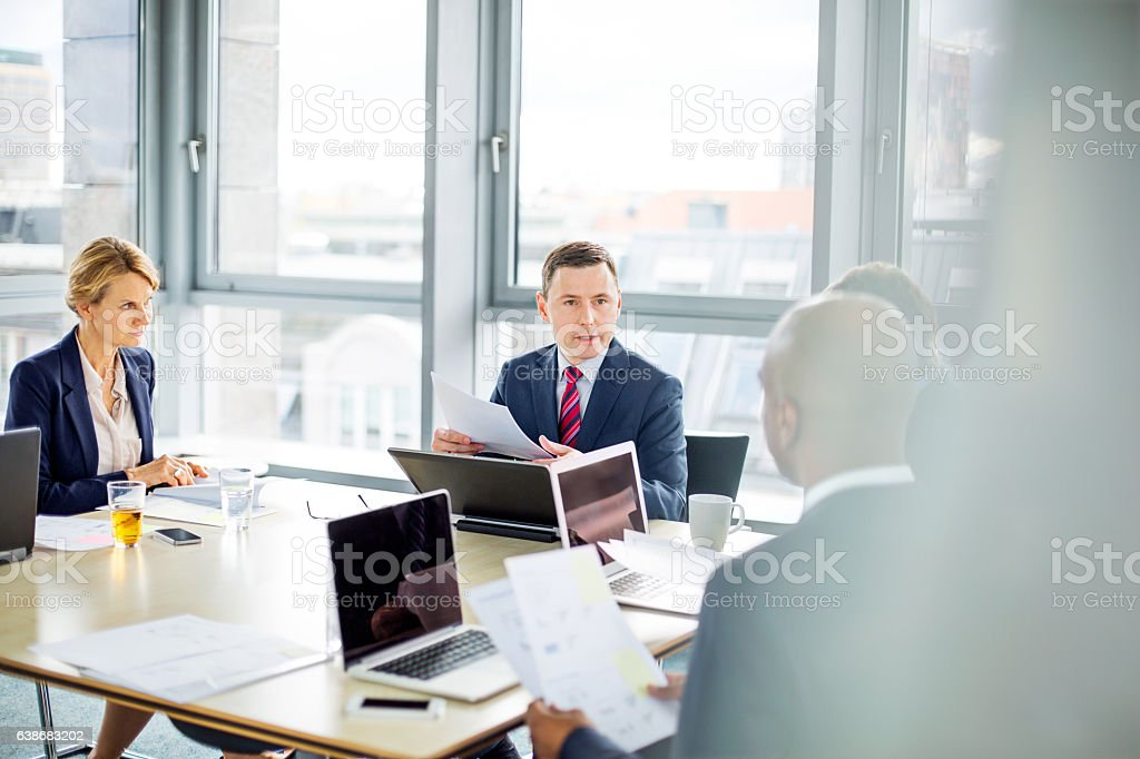 Corporate professional having a meeting stock photo