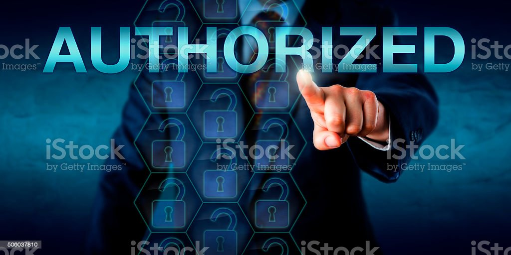 Corporate User Touching AUTHORIZED Onscreen stock photo