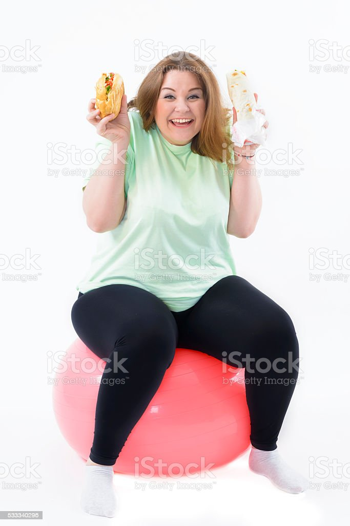 Corpulent Woman Having Addiction to Unhealthy Food stock photo