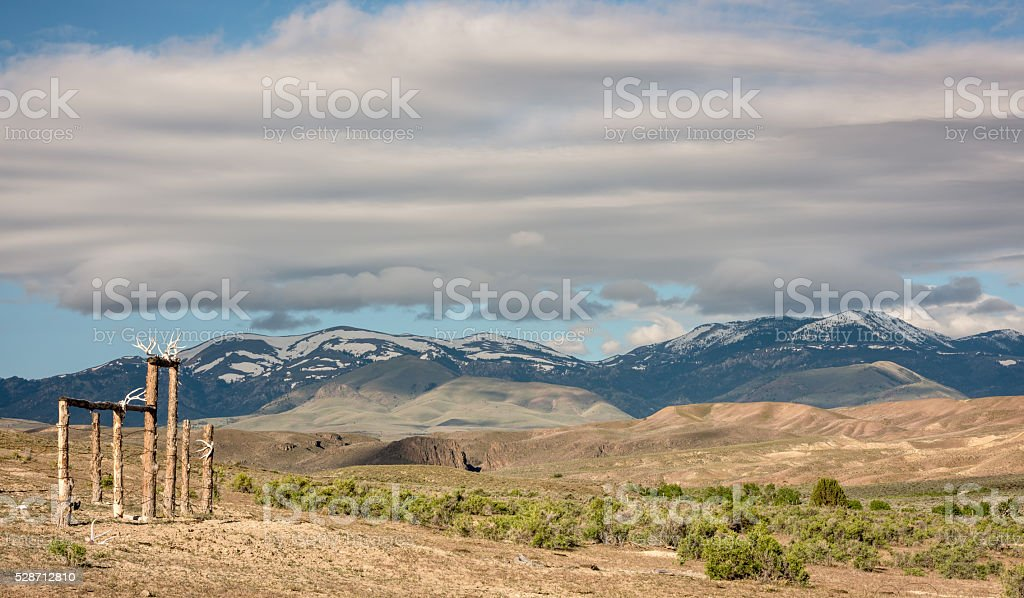 Corral with antlers and Owyee Mountains with snow stock photo