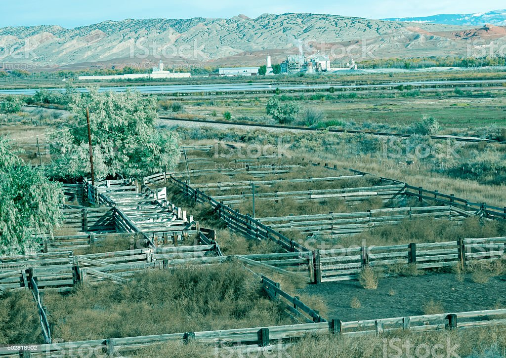Corrals and potash plant in rural Wyoming stock photo