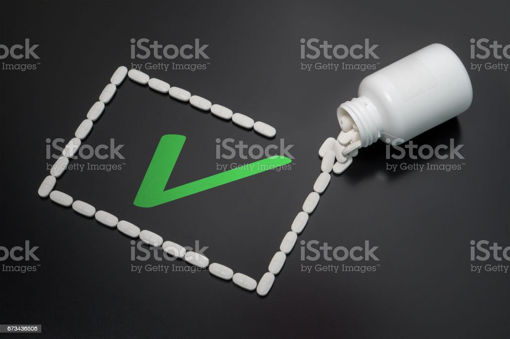 Correct and working cure found. Successful healing process, beating a disease and getting well with the right pills. stock photo