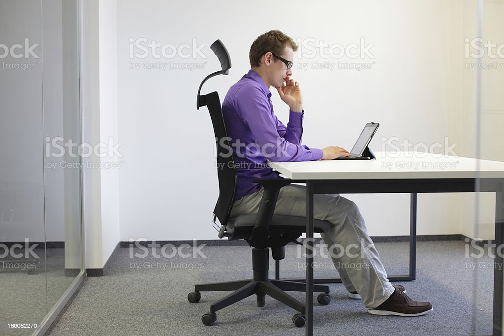 correct sitting position at desk with tablet stock photo