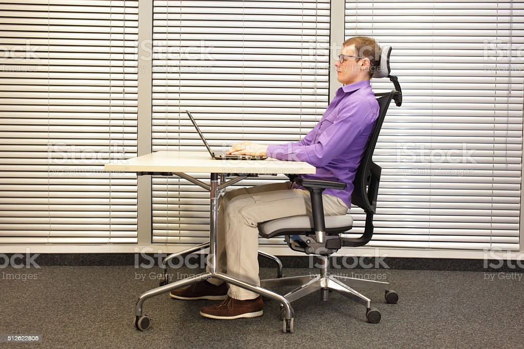 correct sitting position at workstation stock photo