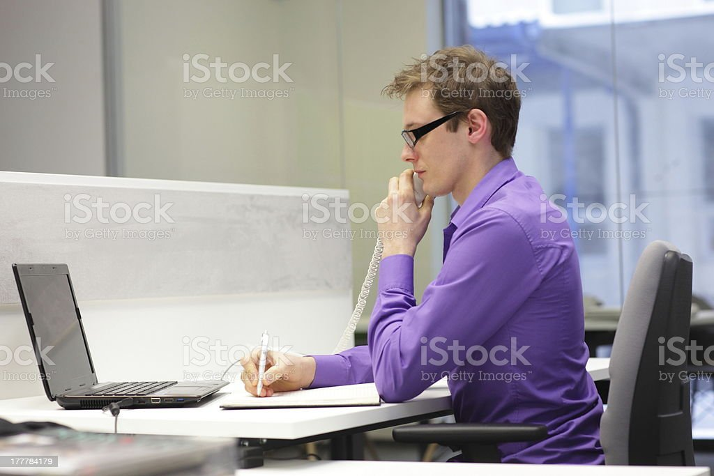 correct sitting position - man working in the office stock photo