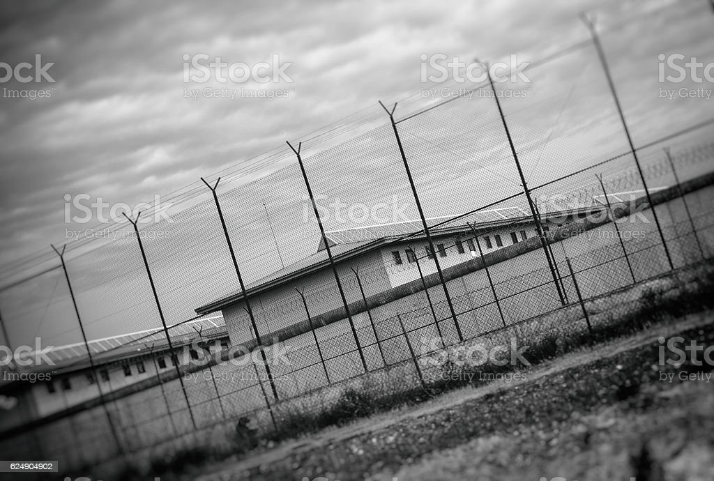 Correctional Facility outside the fence. Black and white. stock photo