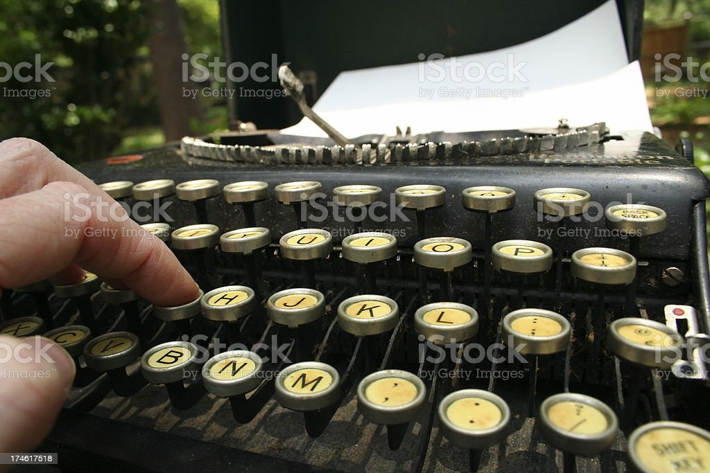 Correspondent using Antique Typewriter stock photo