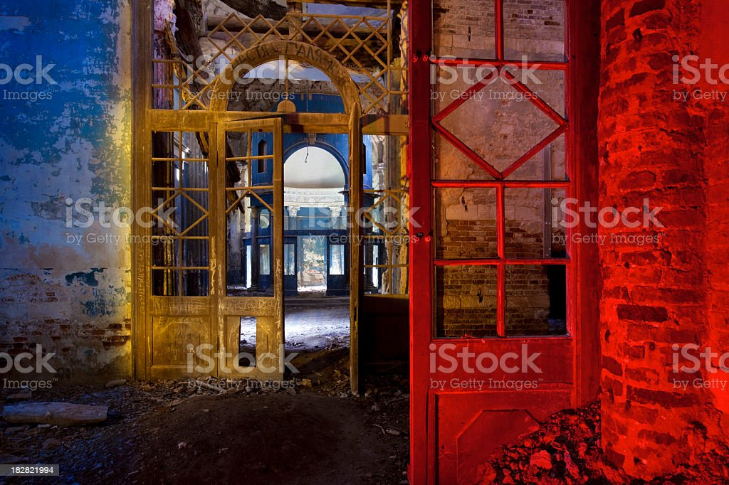 Corridor in abandoned church illuminated colored lights royalty-free stock photo
