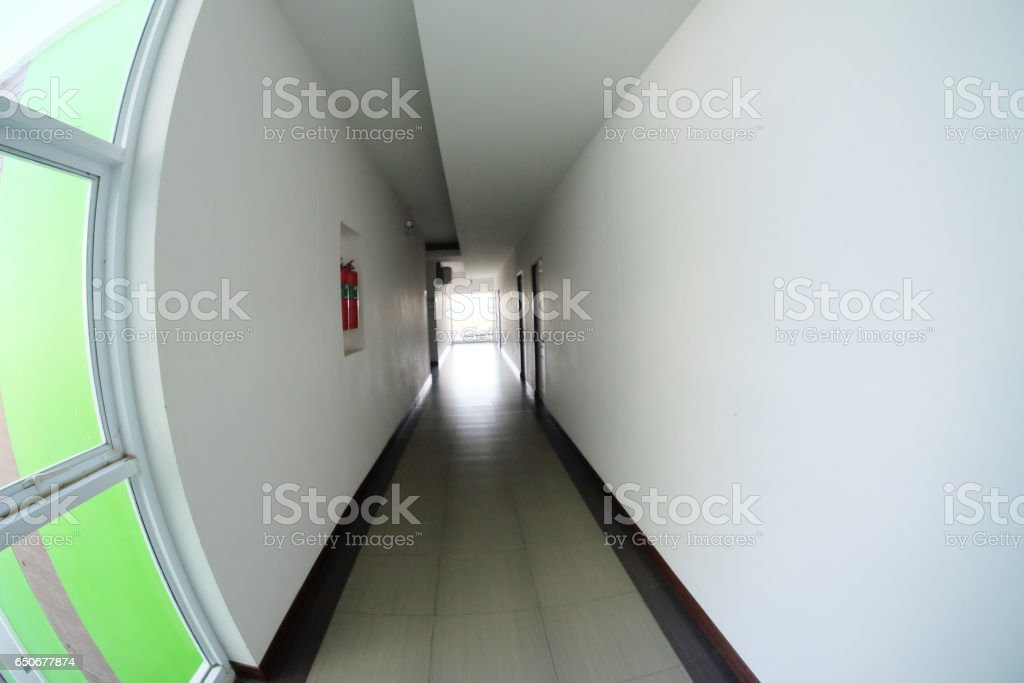 Corridor in hotel building with apartment rooms stock photo