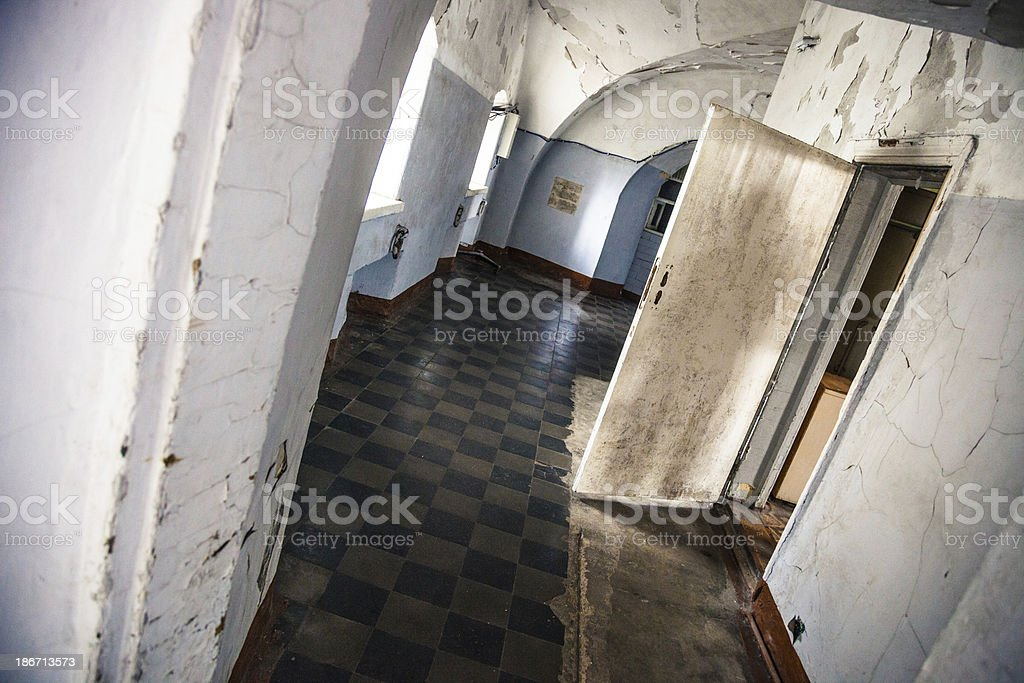 Corridor of an old abandoned madhouse royalty-free stock photo