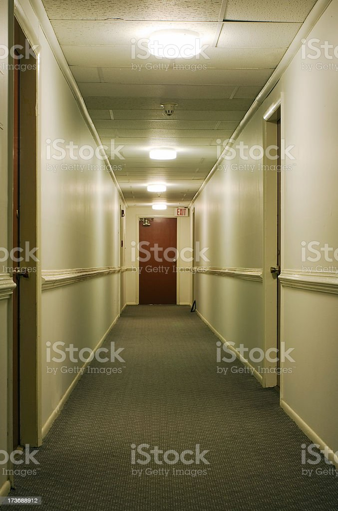 Corridor with exit sign stock photo