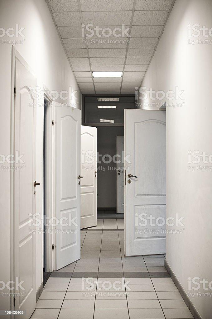 corridor with many doors open royalty-free stock photo