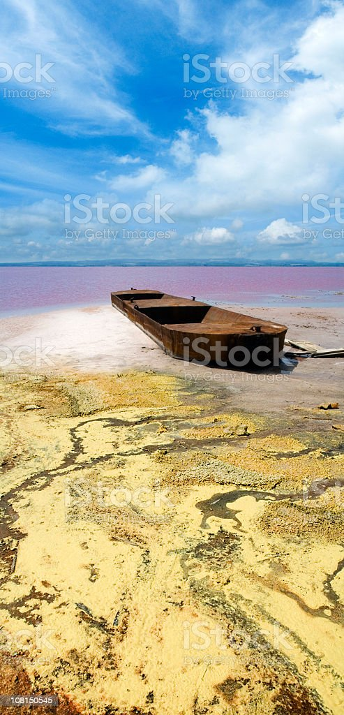 Corroded Barge Sitting on Shore of Salt Lake royalty-free stock photo