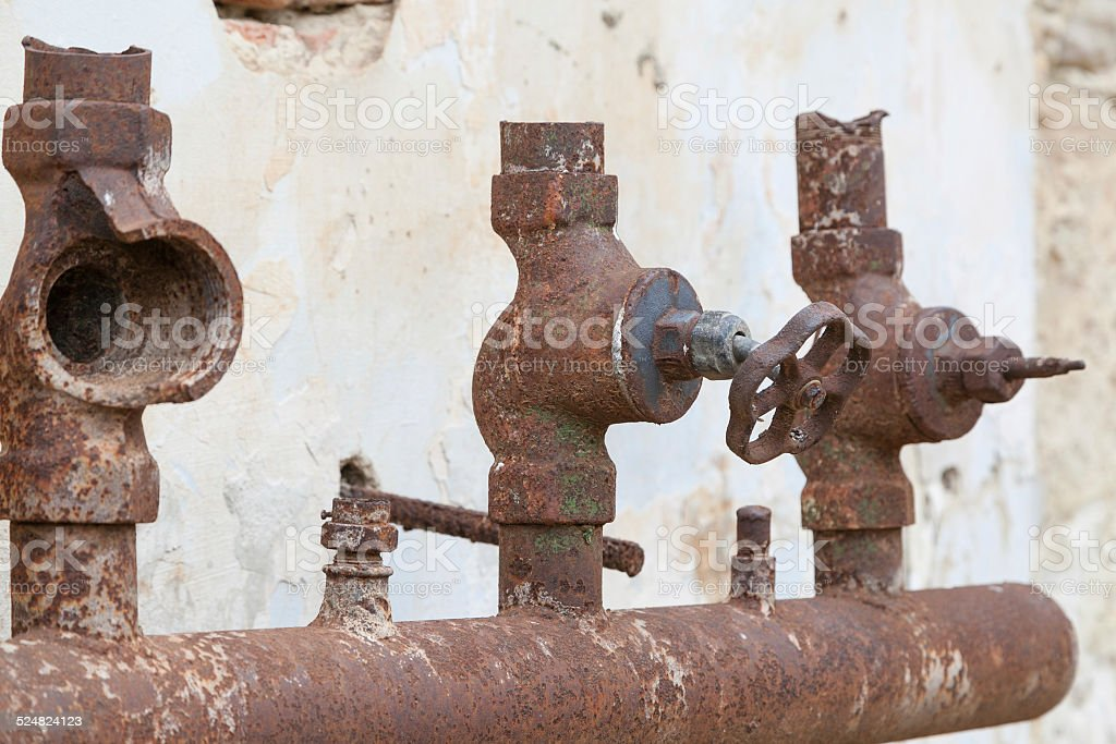 Corroded water faucets stock photo