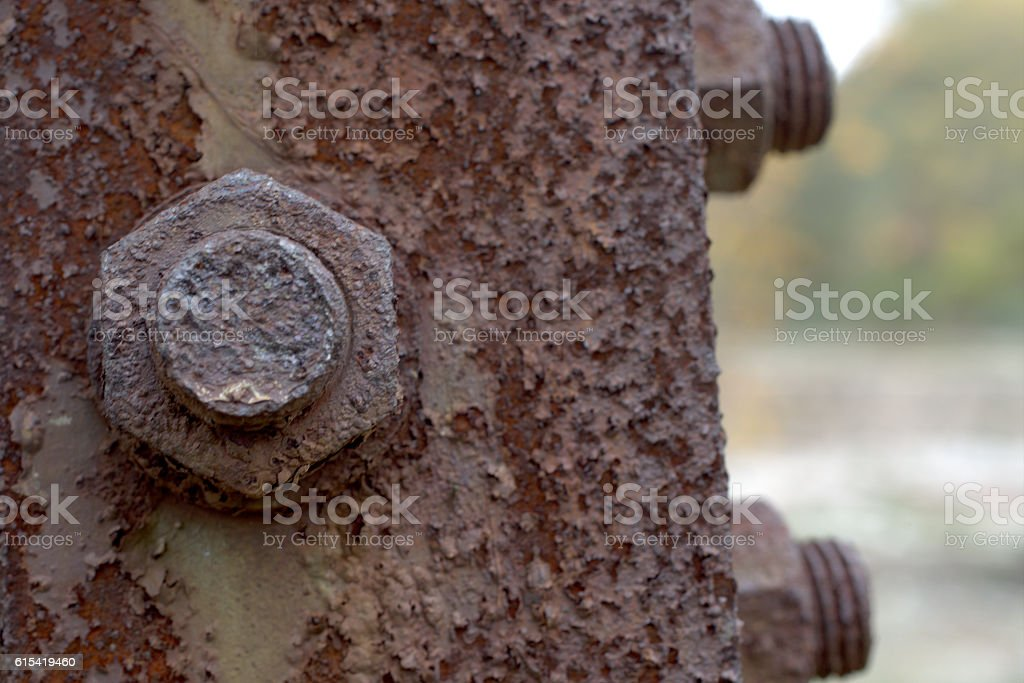 Corrosive rusted bolt with nut. Grunge industrial construction close up. stock photo