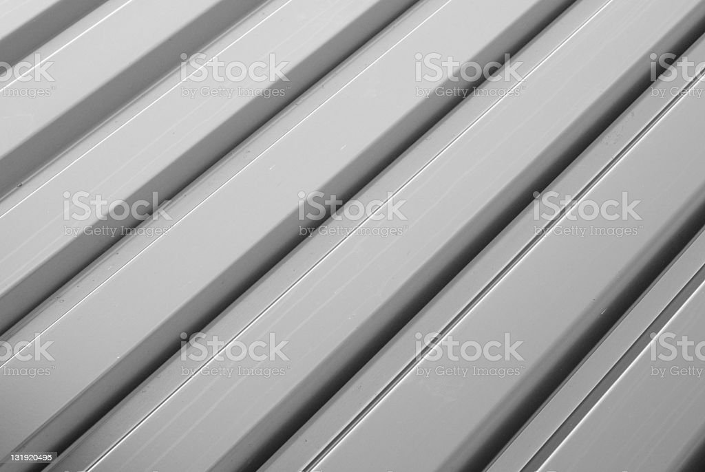 Corrugated anodized aluminum sheet in white stock photo