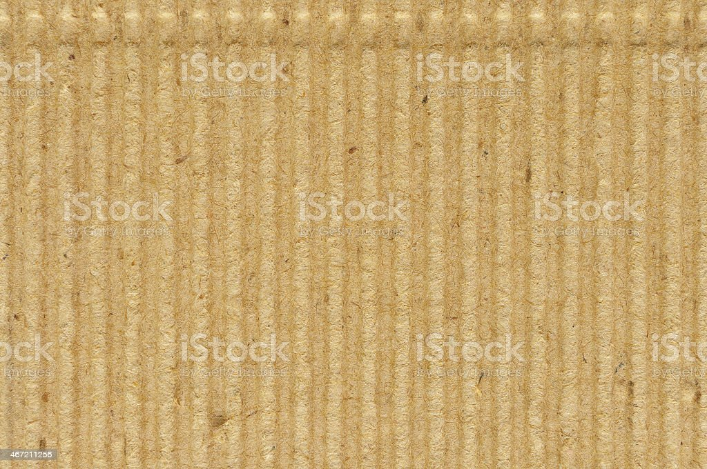 Corrugated cardboard goffer paper texture, bright rough old recycled background stock photo