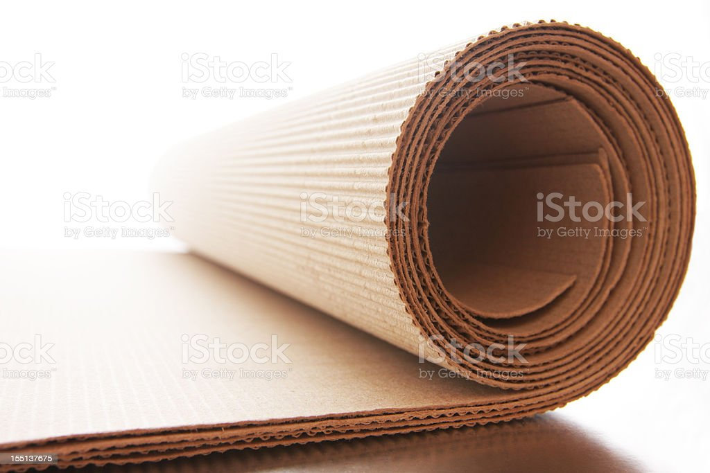 Corrugated cardboard roll on white background stock photo