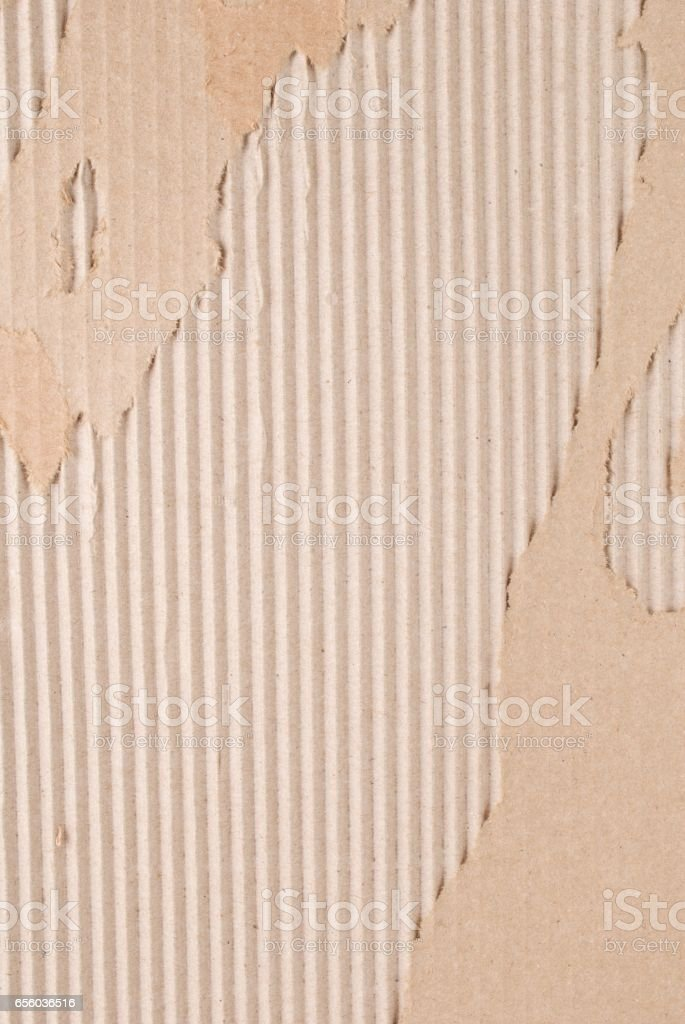 Corrugated Cardboard with Paper Face Partially Peeled Off stock photo