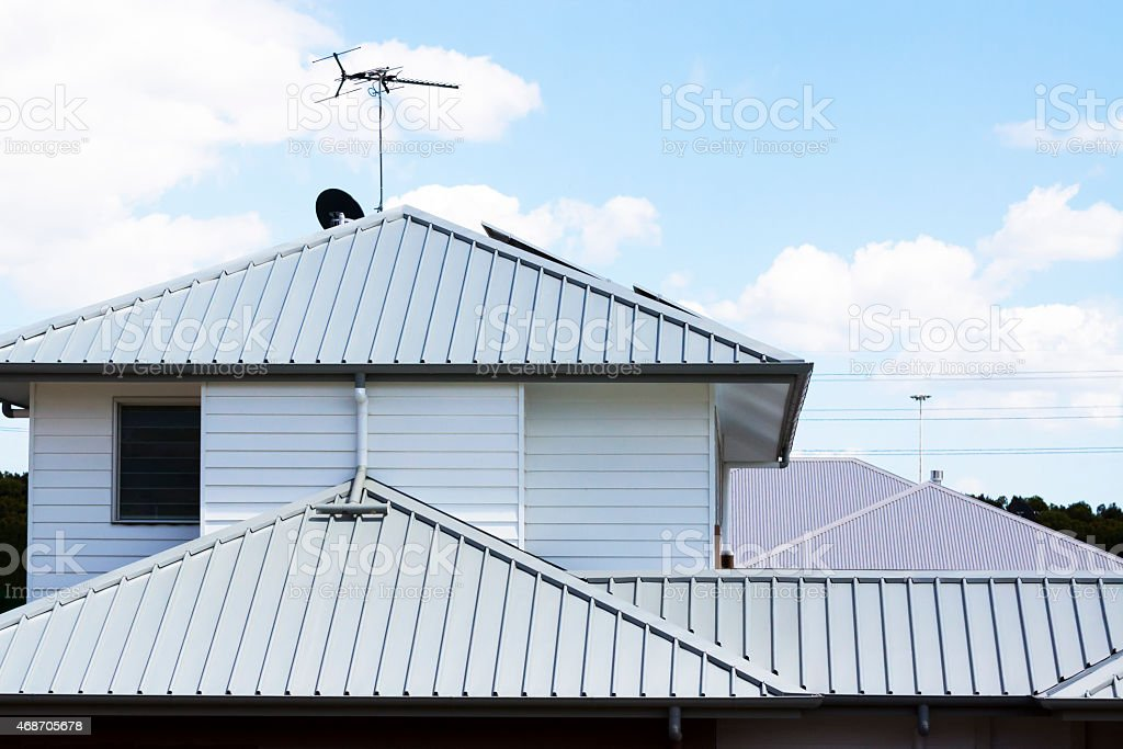 Corrugated iron roofs of modern houses stock photo