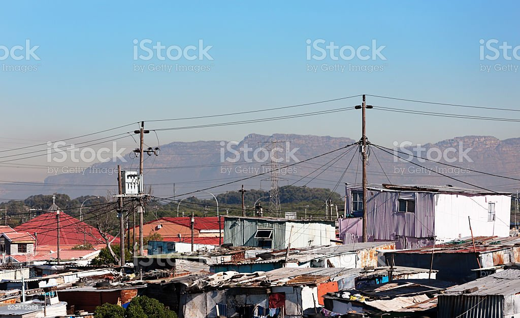 Corrugated iron shacks in front of Table Mountain stock photo