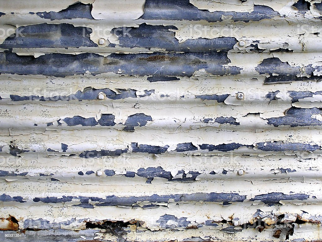 Corrugated iron with flaked paint and rust royalty-free stock photo