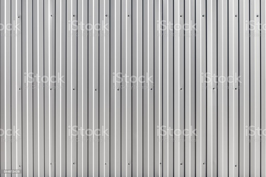 Corrugated metal wall, metal construction fence. Texture stock photo