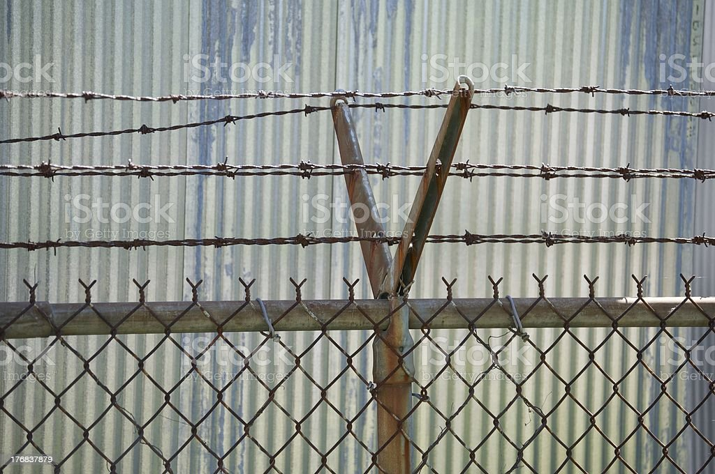 Corrugated Metal with fencing stock photo