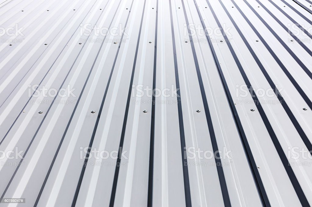 corrugated steel cladding with rivets on industrial building stock photo