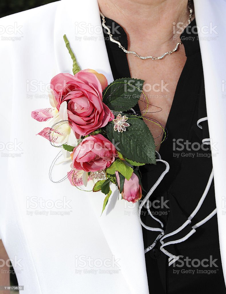 Corsage on Mother of the Bride royalty-free stock photo