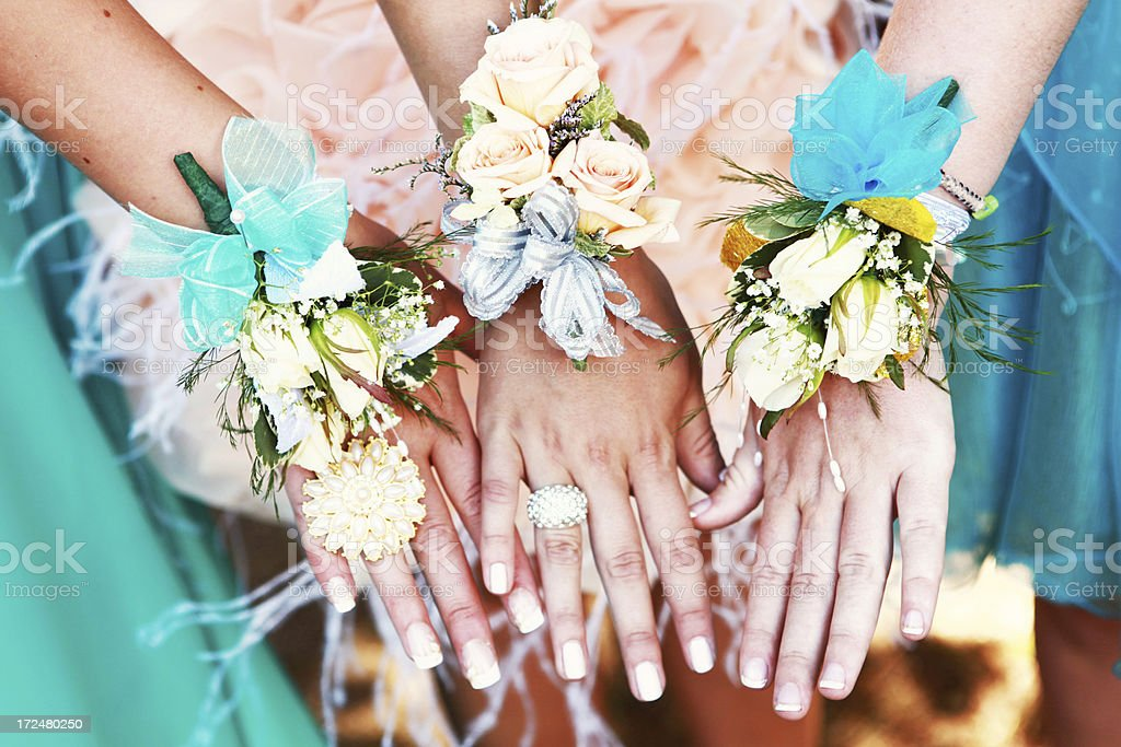 Corsages on the Wrists of Teen Girls stock photo