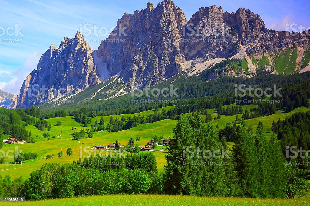 Cortina Alpine village meadows sunrise, Dolomites, Italian Tirol alps stock photo
