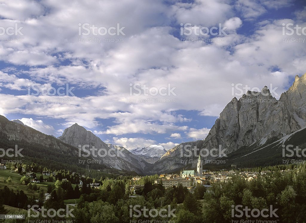 Cortina Italy surrounded by Dolomites Mountain Peaks stock photo