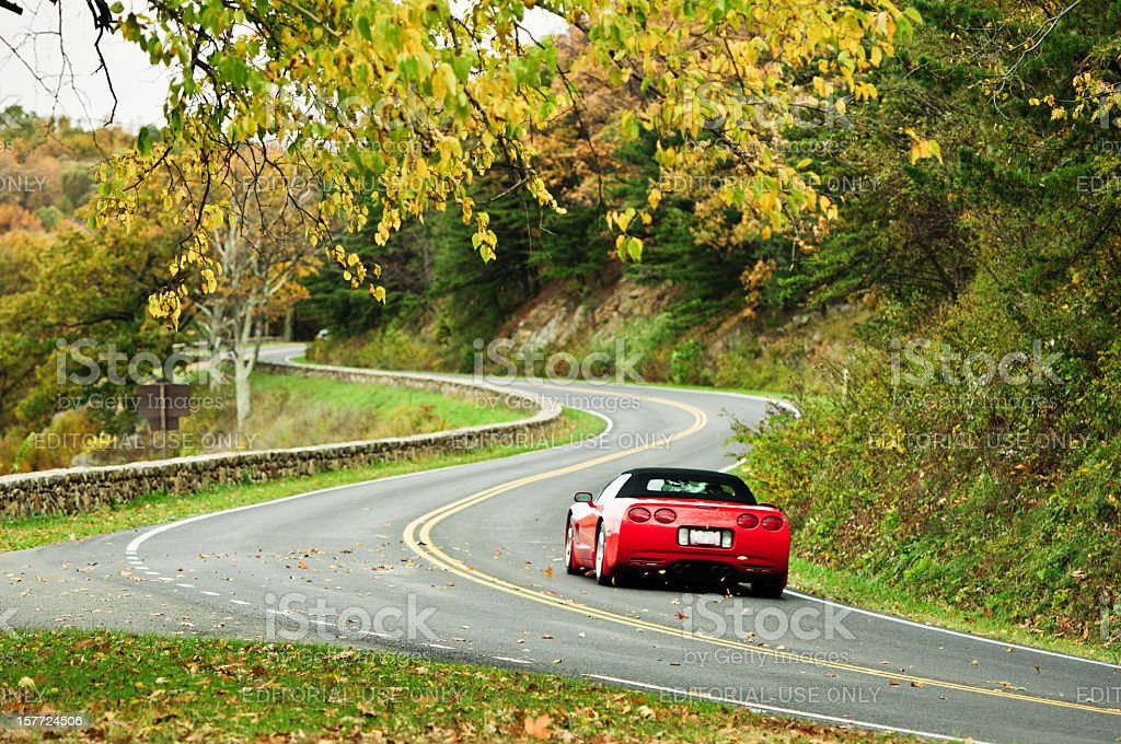 Corvette On Autumn S-Curved Road stock photo
