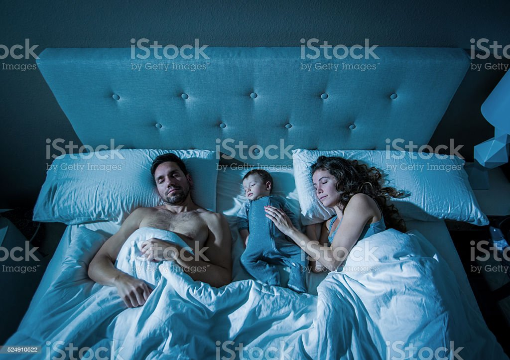 Cosleeping with baby at night stock photo