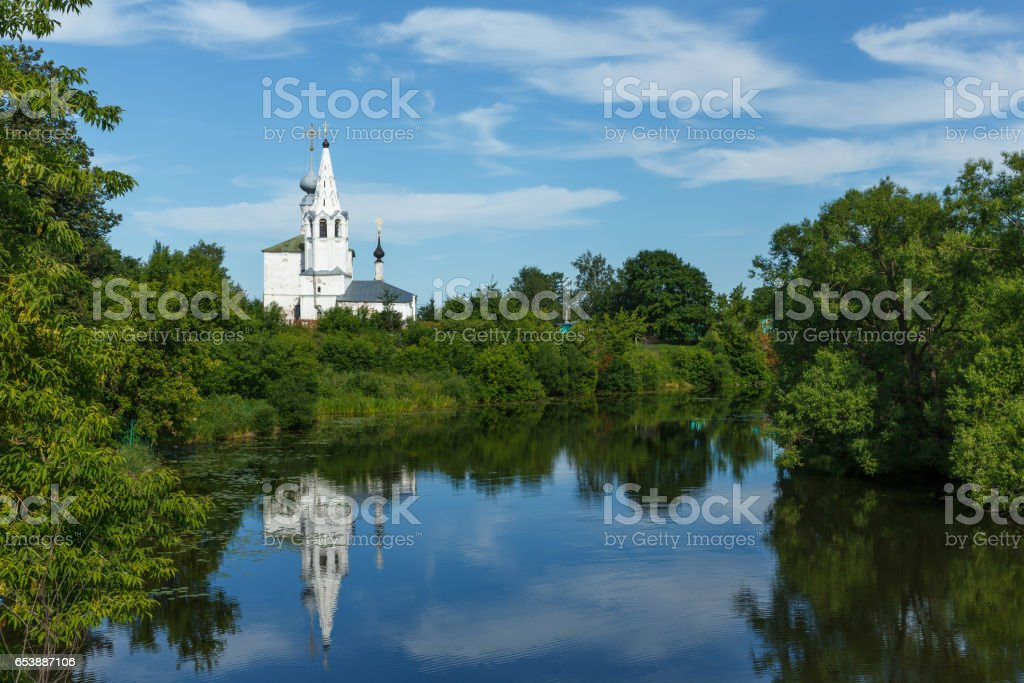 Cosmas and Damian Church with reflection in the river in Suzdal stock photo