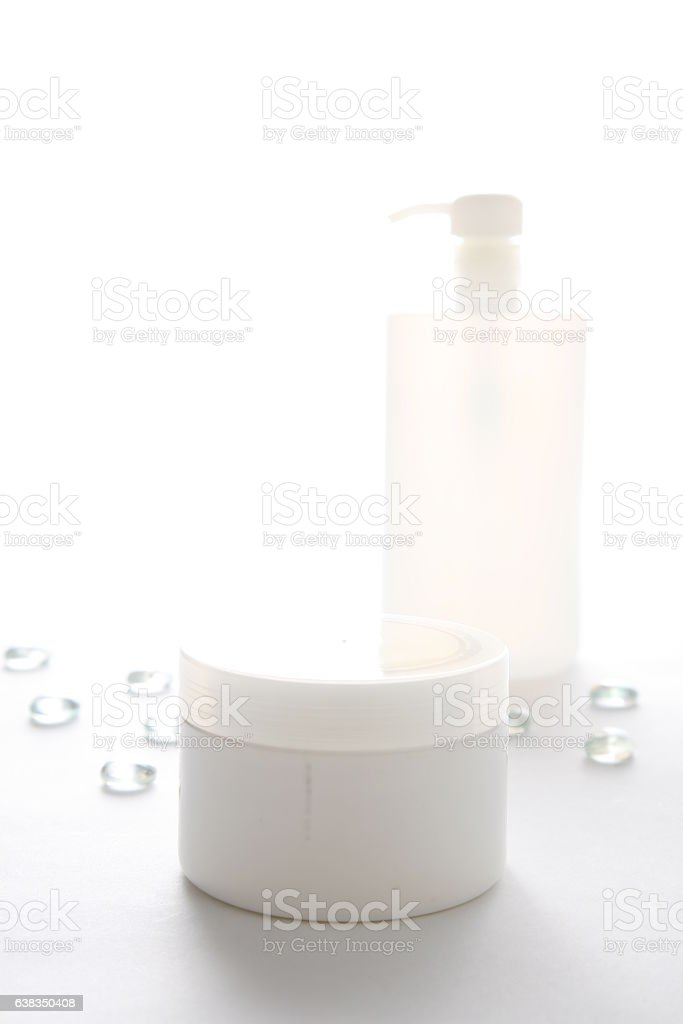 Cosmetic bottle and jars  with diamonds vector art illustration