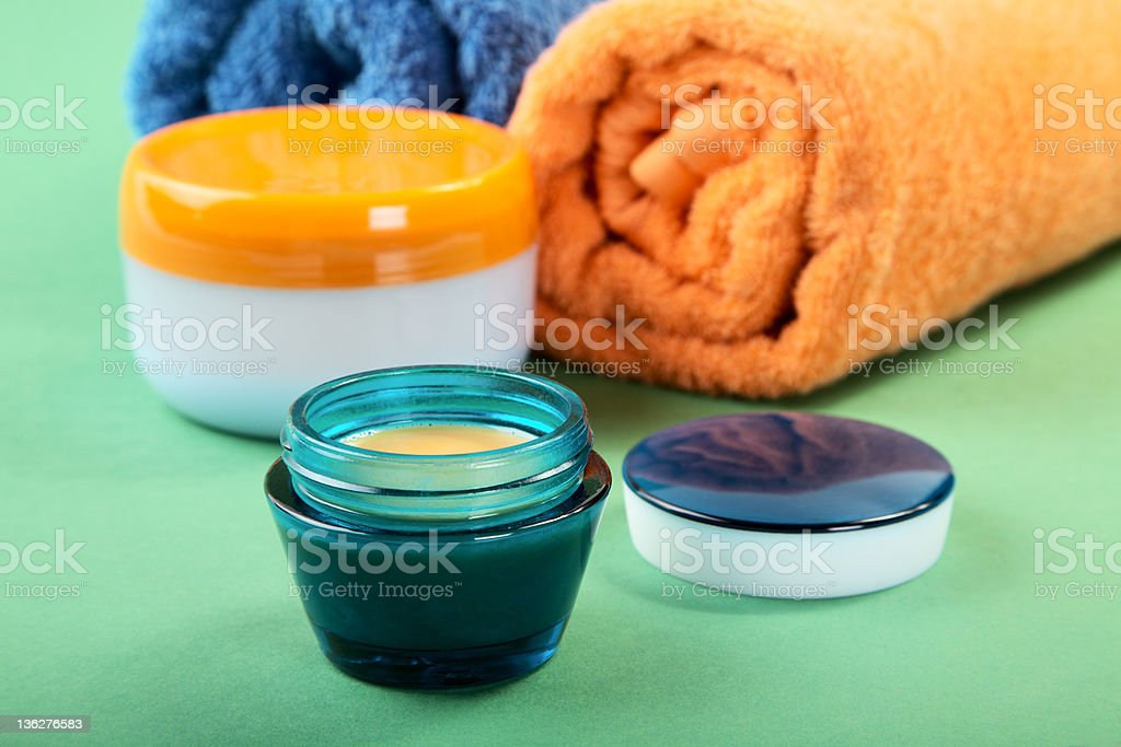 Cosmetic cream and towels royalty-free stock photo