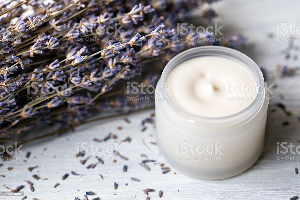 Cosmetic cream for face with lavender flowers stock photo