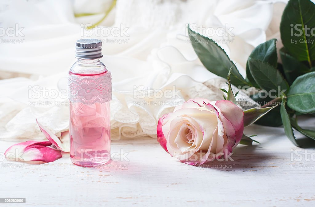 cosmetic cream with pink roses on a wooden table stock photo