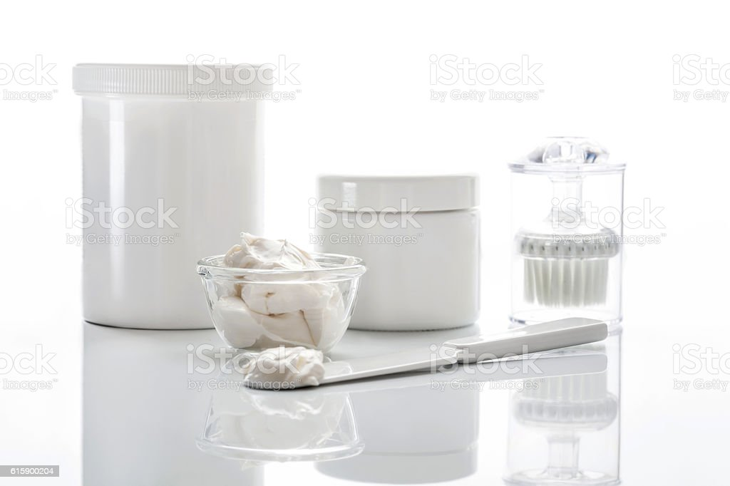 cosmetic face mask on a table with a cosmetic spatula stock photo