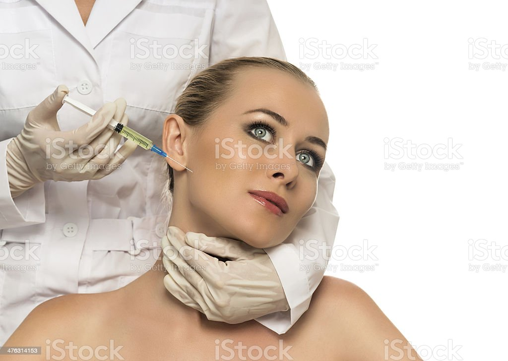 Cosmetic injection to the pretty Beautiful woman face royalty-free stock photo